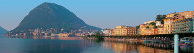 Lugano on the shores of Lake Lugano and on the foot of Mt. Bre