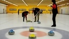 Curling at the covered ice rink of the Gstaad Sports Center