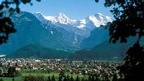 Interlaken, Switzerland with view of Eiger, Moench and Jungfrau, the famous peaks of the Bernese Alps