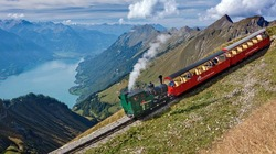 The Brienz- Rothorn mountain railway in the Bernese Oberland - one of many Swiss mountain railways that accommodate tourists to visits wonderful peaks of the Swiss Alps