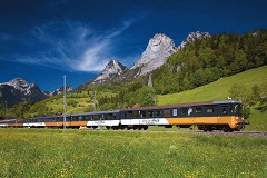 The scenic train Golden Pass on its way from Montreux to Interlaken through the Simmental Valley in the Bernese Oberland