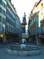 Old Town of Neuchatel with one of its numerous fountains