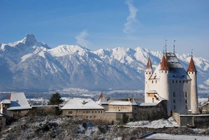 the picturesque castle of Thun and the flat-topped Stockhorn peak