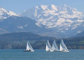 watersports on and in Lake Thun and the impressive peaks of the Bernese Alps