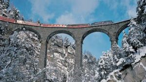 The Bernina Express, the scenic train of the Rhaetian Railways in the Graubunden, Switzerland, with its many bridges, viaducts and tunnels has been named a UNESCO World Heritage Site.