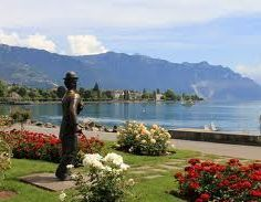 the Charlie Chaplin statue in Vevey, Switzerland - one of many celebrities attracted by the Alpine panorama and the mediterranean feel of the Lake Geneva Region