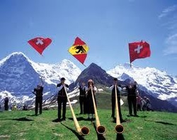 Swiss traditions - Alphorn, folklore and the snow-covered peaks of the Alps