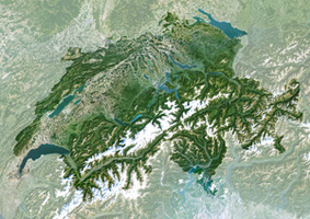 Aerial View of Switzerland with its glacier-covered peaks of the Alps and beautiful lakes