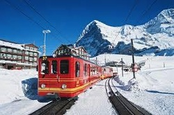 Jungfrau Mountain Railway on its way to the Jungfraujoch - Top of Europe; stopover at the Kleine Scheidegg in front of the famous Eiger North Face
