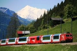 The world-famous Glacier Express connecting the Swiss mountain resorts of Zermatt, Davos and St. Moritz